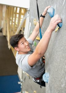 student on a climbing wall
