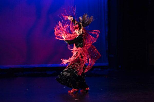 A dancer spinning on stage of LeFevre Theatre