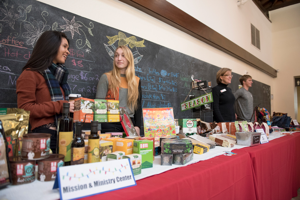 Students working at a booth during Christmas selling fair trade products