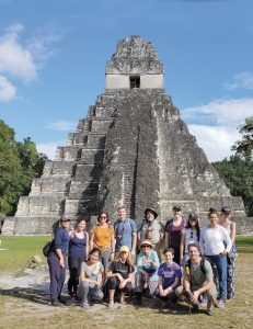 Students lined up for a group photo in front of a temple in Guatemala