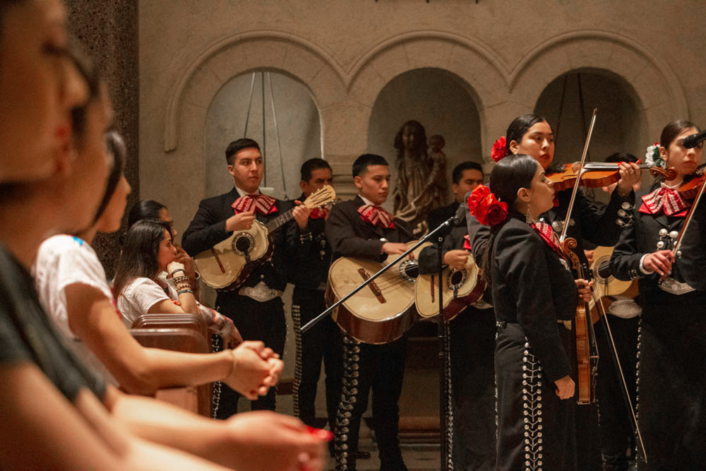 A mariachi band playing in the chapel during mass